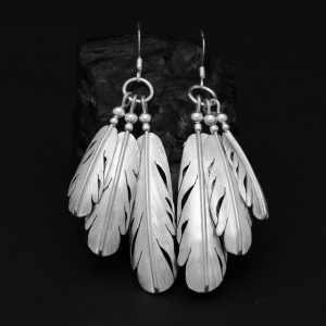 Silver feather fan earrings hand crafted by Harvey Chavez of the Kewa tribe