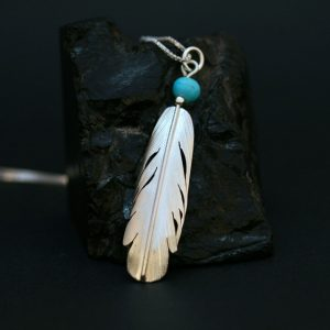 Feather pendant by Harvey Chavez