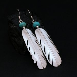 Feathers with turquoise by Harvey & Janie Chavez