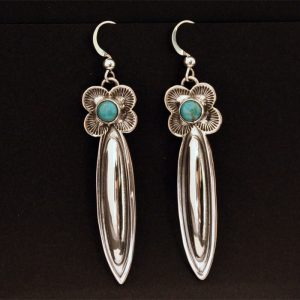 Turquoise and silver repoussé earrings by Jennifer Medina