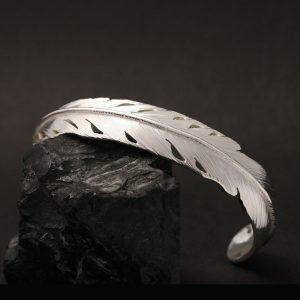 Silver feather bracelet by Harvey Chavez