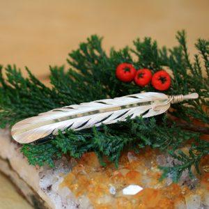 Feather hair clip by Harvey Chavez