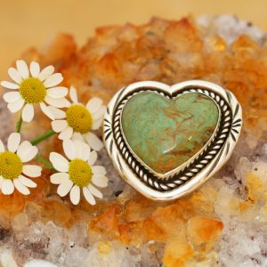 Turquoise heart brooch by Harvey Chavez