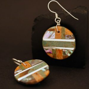 Round earrings by Tanner Medina