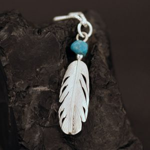 Feather pendant by Harvey Chavez