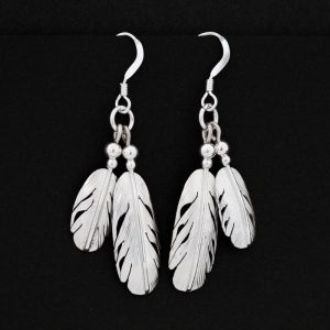 Silver feathers earrings by Harvey Chavez