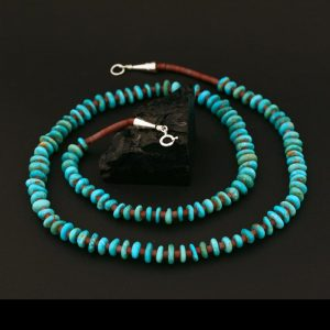 Long turquoise necklace by H & J Chavez