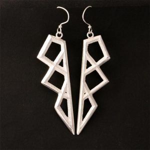 Silver tufa cast earrings by Tim Herrera