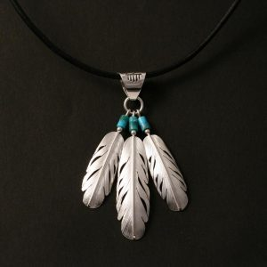 Raincloud & feathers pendant by Harvey & Janie Chavez