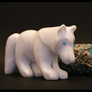 White wolf carving by Clive Hustito