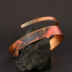 Spiral copper bangle by Gwaai Edenshaw, Haida