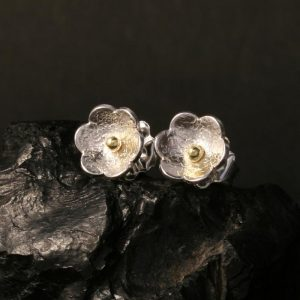 Flower stud earrings by Chris Priutt