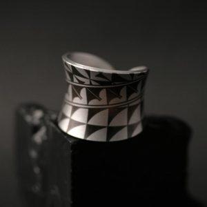 Laser etched zirconium Laguna Pueblo ring by Pat Pruitt & Marla Allison
