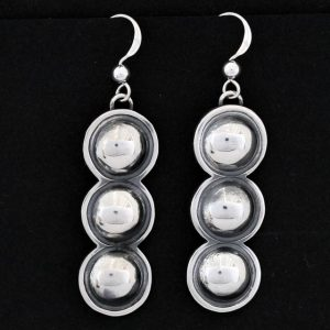 Silver circles repoussé earrings by Jennifer Medina, Kewa Pueblo