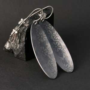 Zirconium earrings by Pat Pruitt
