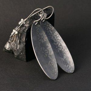 Zirconium earrings by Pat Pruitt