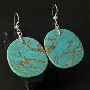 Traditional slab earrings by Jennifer Medina