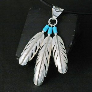 Triple Feather Pendant by Harvey Chavez