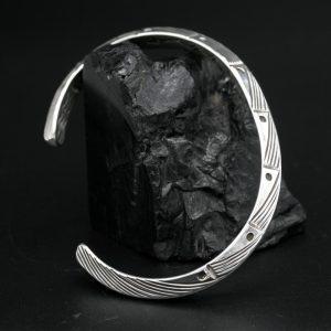 Triangular stamped silver bracelet by Allen B Paquin.