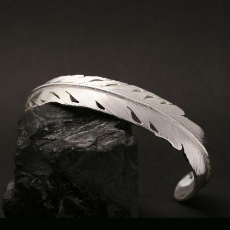 Silver feather bracelet by Harvey Chavez