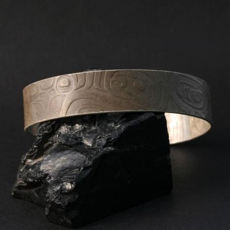 Oxidised silver bracelet by Gwaai Edenshaw, Haida
