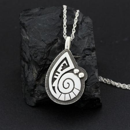 Ammonite silver pendant by Anthony Honahnie, Hopi