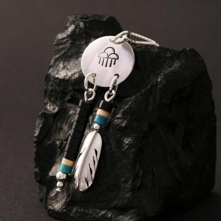Raincloud pendant with feather by H & J Chavez