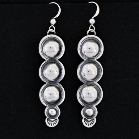 Repoussé silver earrings by Jennifer Medina, Kewa.