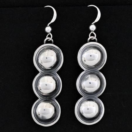 Silver circles repoussé earrings by Jennifer Medina, Kewa Pueblo