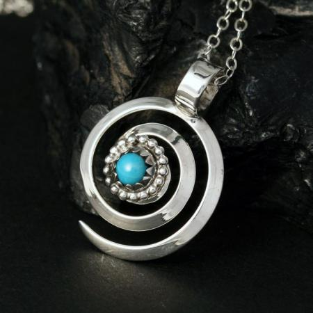 spiral pendant handcrafted from sterling silver and set with turquoise by Lorraine Martinez, Kewa.