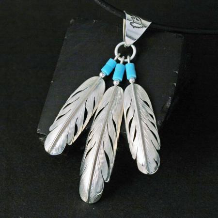 Triple Feather Pendant by Harvey Chavez