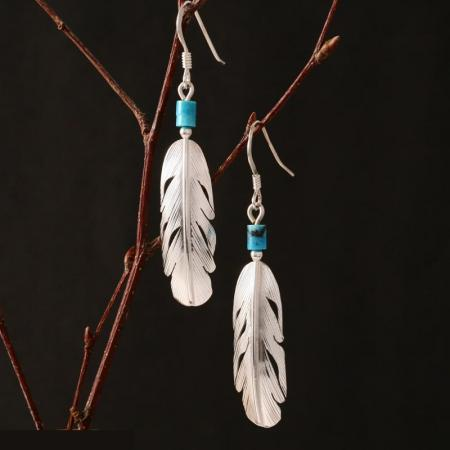 silver feather earrings by Harvey Chavez