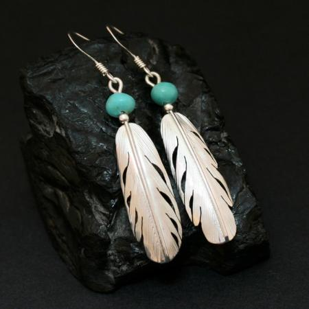 Feather earrings by Harvey Chavez