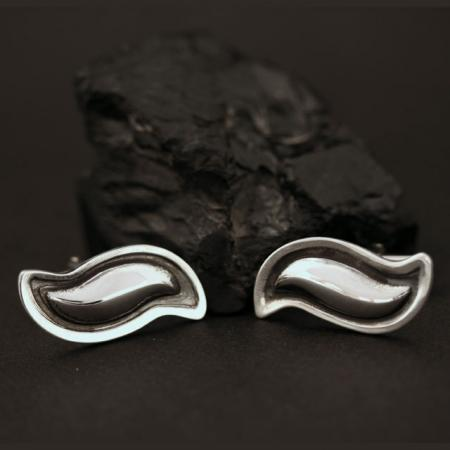 Silver cufflinks by Jennifer Medina